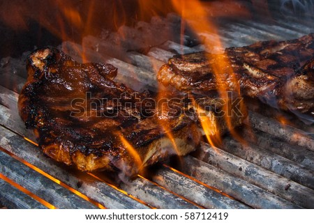Cooking Steak on Fire - stock photo