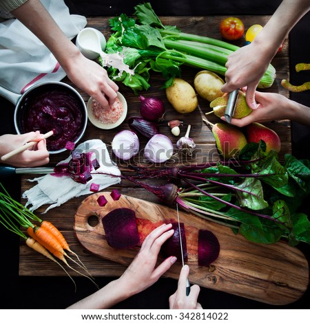 Cooking vegetable soup with beetroot - stock photo