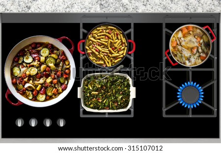 Cooking vegetables and meat on a gas stove top view - stock photo