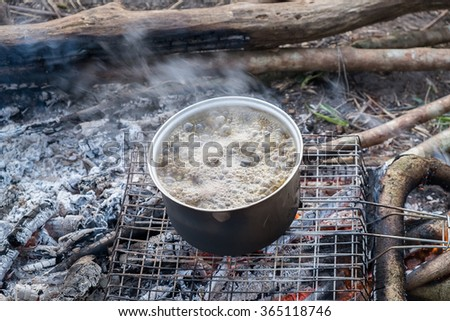 cooking with army pot on bonfire
