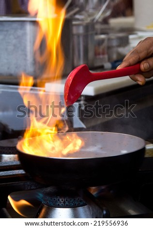 Cooking with flames  - stock photo