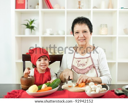 Cooking with grandma is fun - stock photo