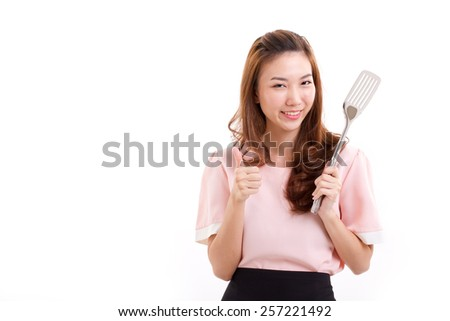 cooking woman giving thumb up - stock photo