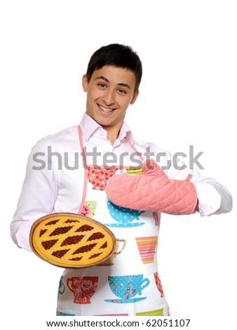 Cooking. Young man in apron baked tasty pie. isolated on white background - stock photo