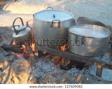cookware on open fire - stock photo