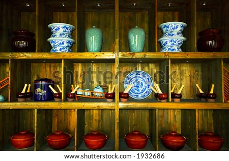 Cookware on the shelf of a Chinese tea house. More with keyword group6f