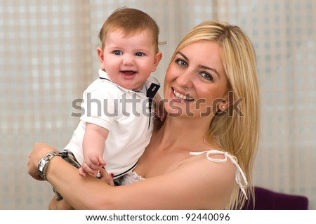 Cool baby boy and his mother laughing. - stock photo