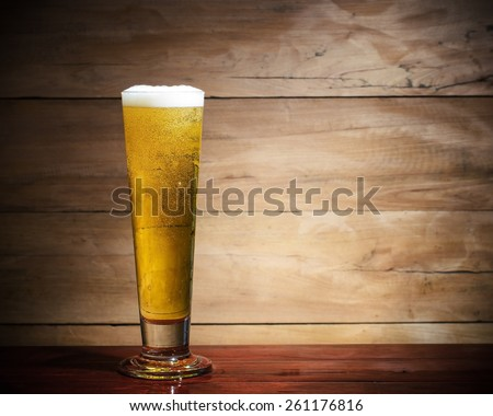 Cool beer on wood background.