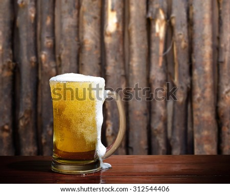 Cool beer on wood background. - stock photo