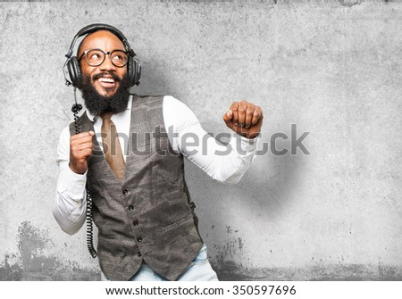 cool black man with headphones dancing - stock photo