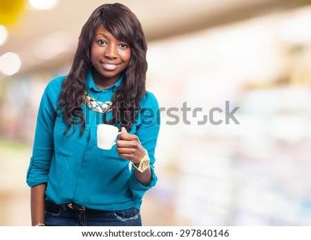 cool black woman drinking coffee - stock photo