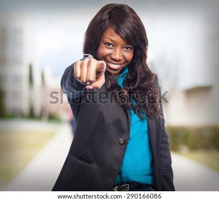 cool black-woman pointing-front - stock photo