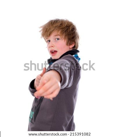 cool boy is pointing in to the camera - stock photo