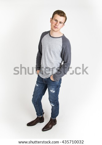 cool boy with cool facial expression  poses in studio isolated on white - stock photo