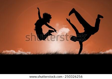 Cool break dancer against sun set - stock photo