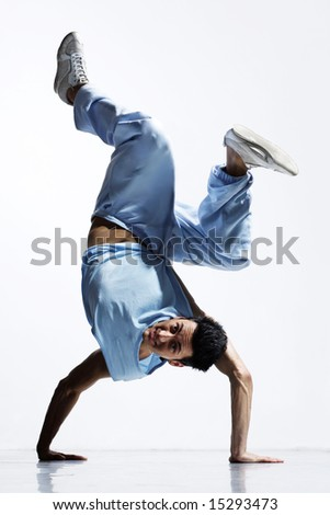 cool breakdance style dancer posing in freeze position - stock photo
