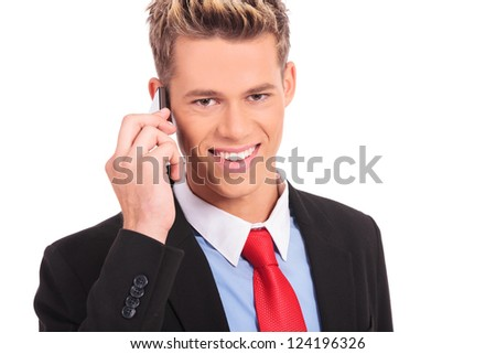 Cool business man talking on mobile phone on white background - stock photo