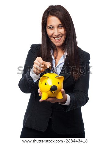 cool business-woman with piggy-bank - stock photo