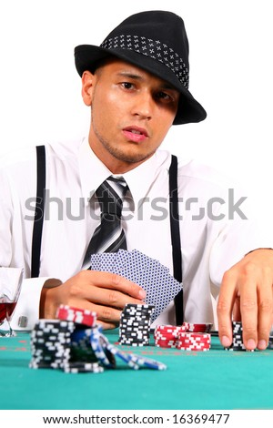 Cool Card Player Young man playing poker with a hat and stylish suit. Isolated over white background. - stock photo