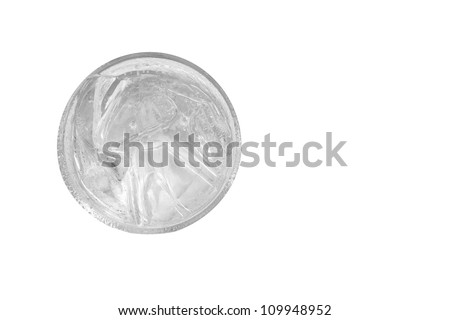 cool clean water with ice in clear glass, top view - stock photo