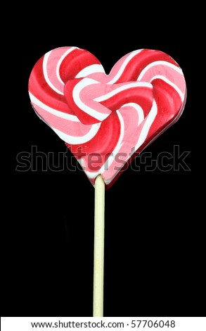 cool colorful lollipop on a black background - stock photo