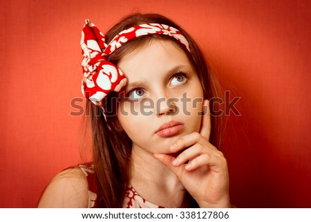 cool cute little girl lost in thought, or remembered - stock photo