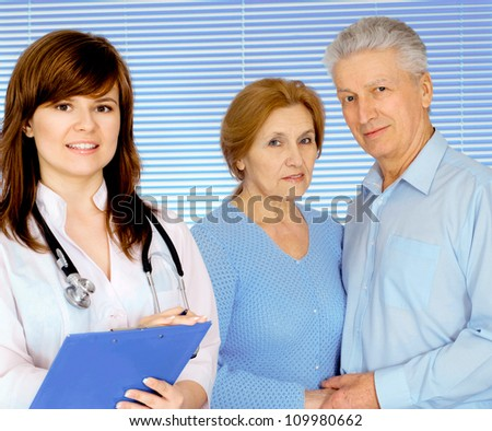 Cool doctor is taking in his office - stock photo