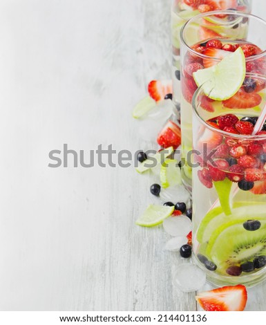 cool drink with fresh berries and fruit on the old wooden background.copy space background. health and diet food - stock photo