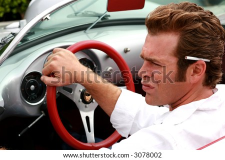 cool dude driving a sports car - stock photo