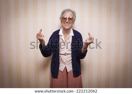 cool elder lady making middle finger sign