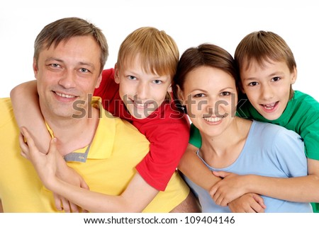 Cool family in bright T-shirts have fun in the company of each other
