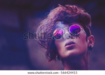 Cool Fashion Model With Modern Pop Hair Styling Wearing Round Color  Sunglasses Smokes Cigarette.Stylish