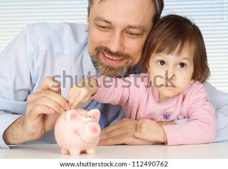 Cool father sits with his daughter at home - stock photo