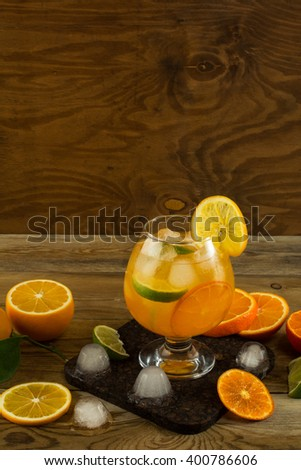 Cool fruit cocktail on wooden table, place for text. Fruit cocktail. Fruit drink. Citrus lemonade. Fruit lemonade. Summer drink  - stock photo