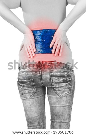 Cool gel pack on a swollen hurting back. Medical concept photo.  - stock photo