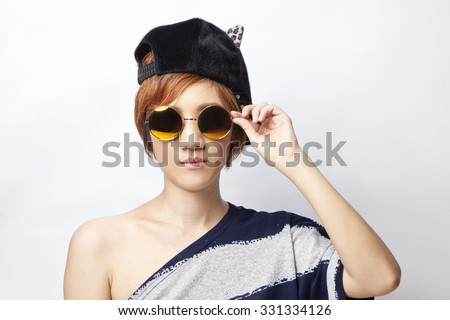 Cool girl on plain background