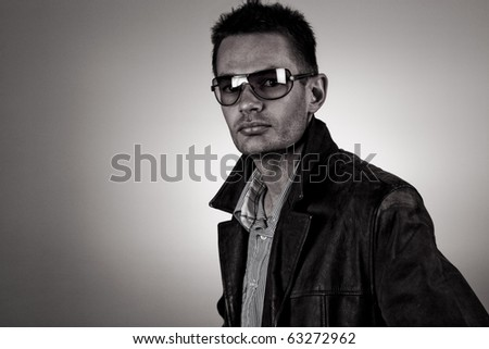Cool guy with sunglasses. Desaturated and grain added. - stock photo