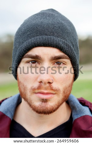 Cool handsome guy with piercing and beard - stock photo