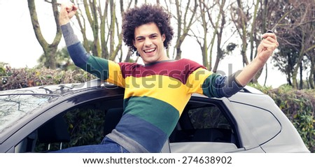 Cool handsome man looking camera happy holding key of car - stock photo