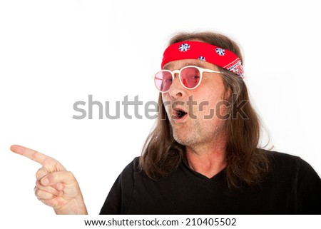 Cool Long Hair Man Wearing Black Shirt Pointing Right on White Background.