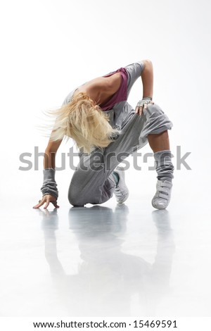 Cool Hip Hop Dance Poses Cool looking and stylish hip-hop dancer posing on white background - stock