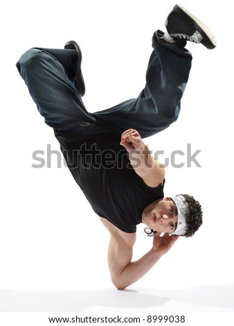 cool looking breakdancer posing on a isolated background - stock photo