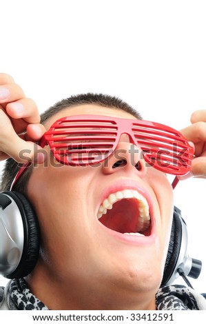 Cool looking guy listening to music and having fun closeup - stock photo