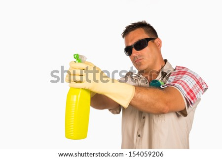 Cool looking guy playing secret agent with his cleaning products - stock photo