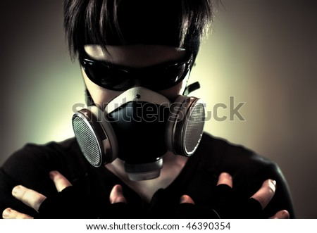 Cool man in protective mask. Dark contrast colors. - stock photo