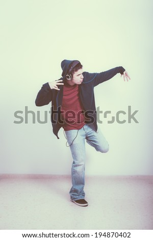 Cool man with headphones dancing. - stock photo