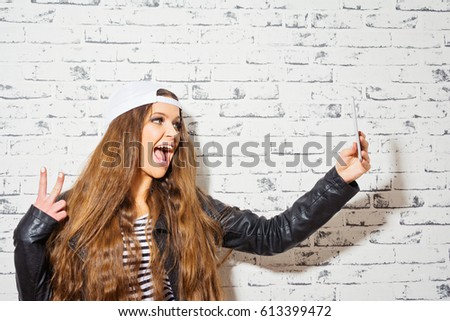 Cool Millennial Teenage Girl Taking A Selfie On Smart Phone. Modern Young  Woman With Her