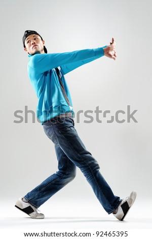 cool modern breakdancer warming up in studio, - stock photo