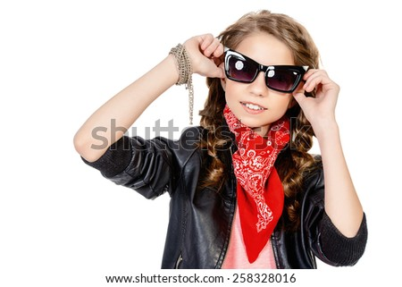 Cool modern girl teenager wearing stylish clothing. Fashion for children. Studio shot. Isolated over white.