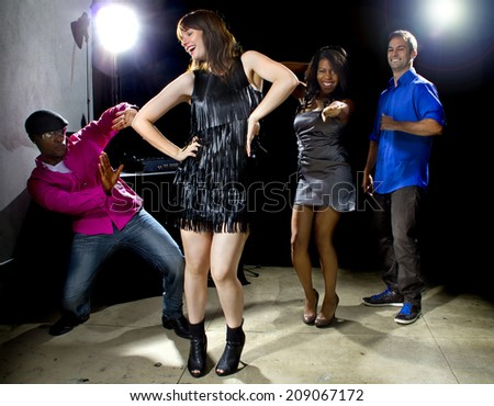 cool people dancing in a nightclub or bar lounge - stock photo